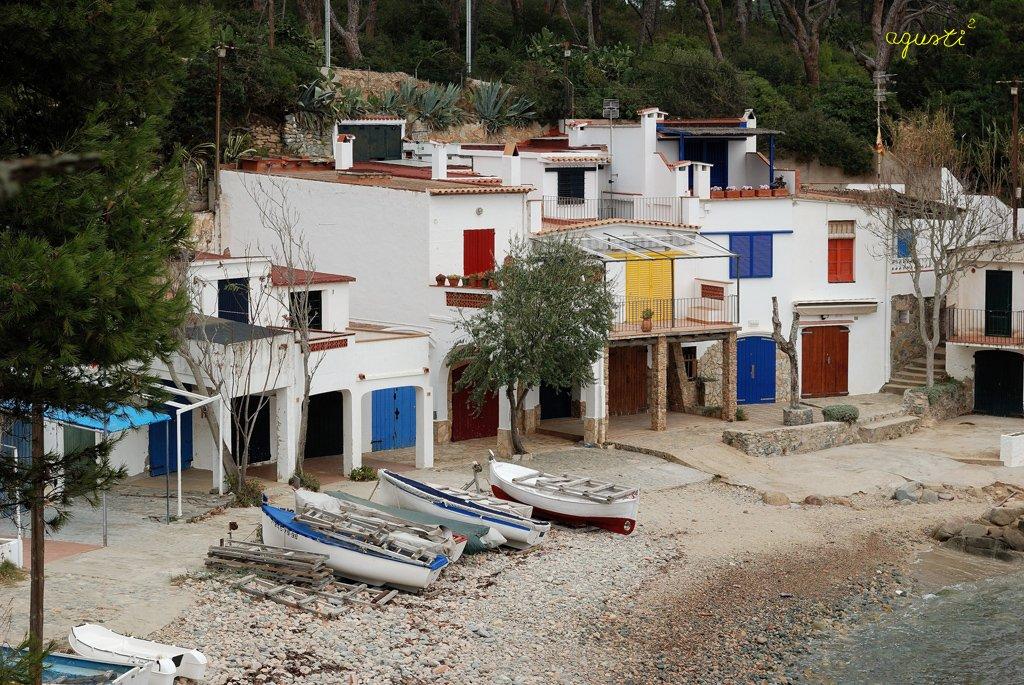 la platja i les barraques de s'Alguer